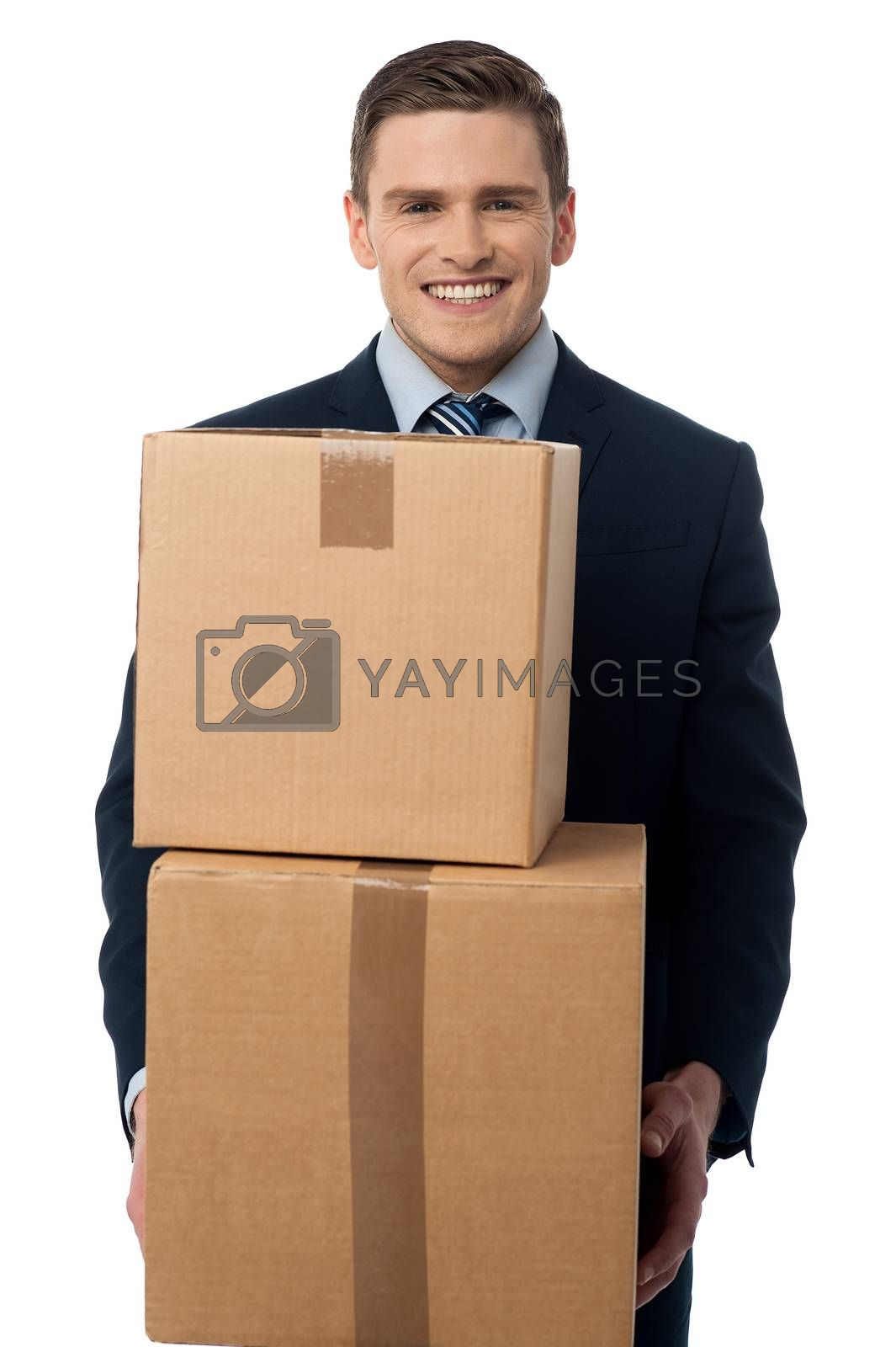 Young man posing with cardboard boxes by stockyimages