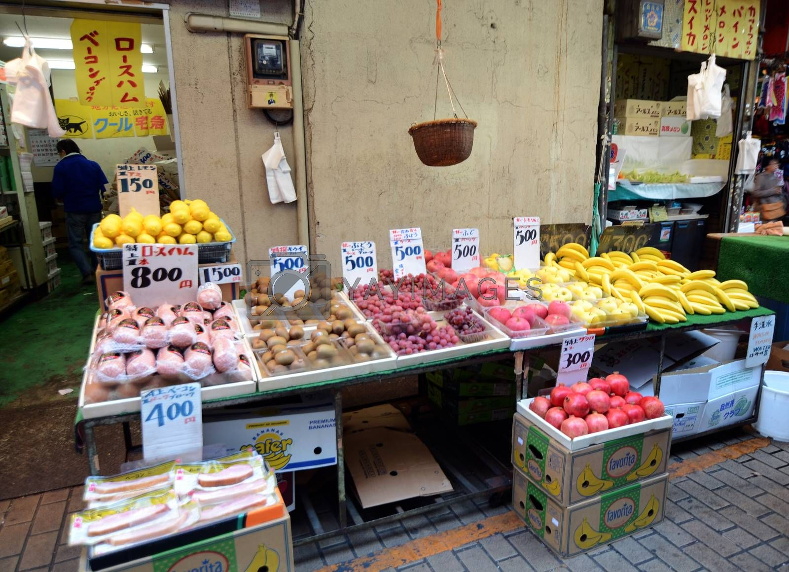 TOKYO, JAPAN- NOVEMBER 22, 2013: Ameyoko is market street,which sell various products, fruit, dried food and spices. Market located in Taito Ward of Tokyo, Japan, November 22 2013