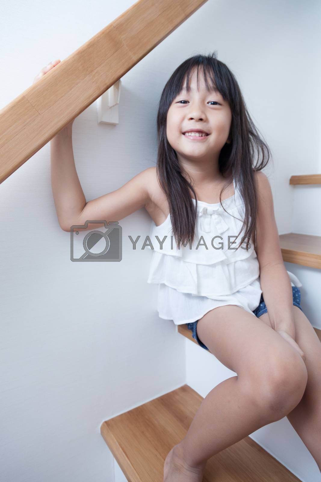 Girl sitting in on the ladder by a454