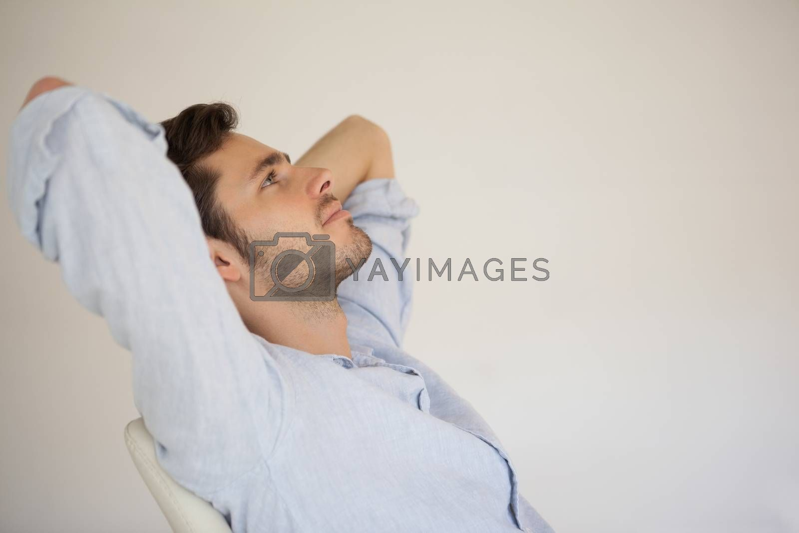 Royalty free image of Casual businessman relaxing at desk leaning back by Wavebreakmedia