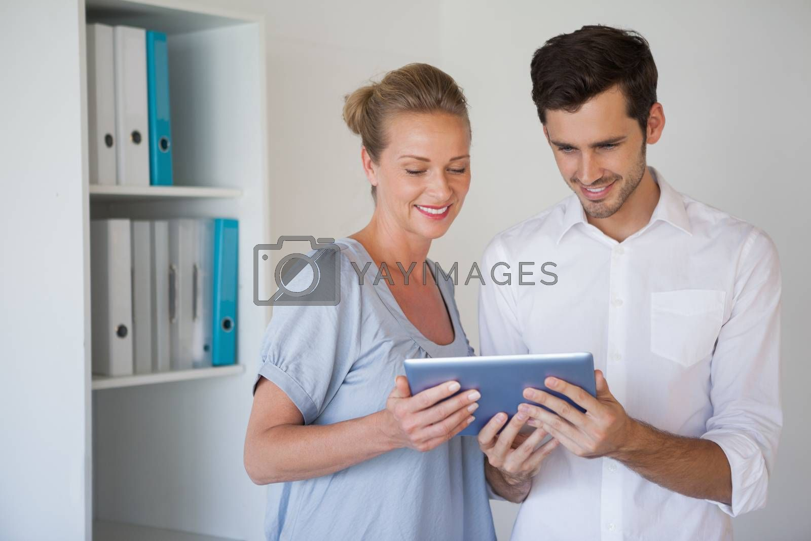 Royalty free image of Casual business team using tablet together by Wavebreakmedia