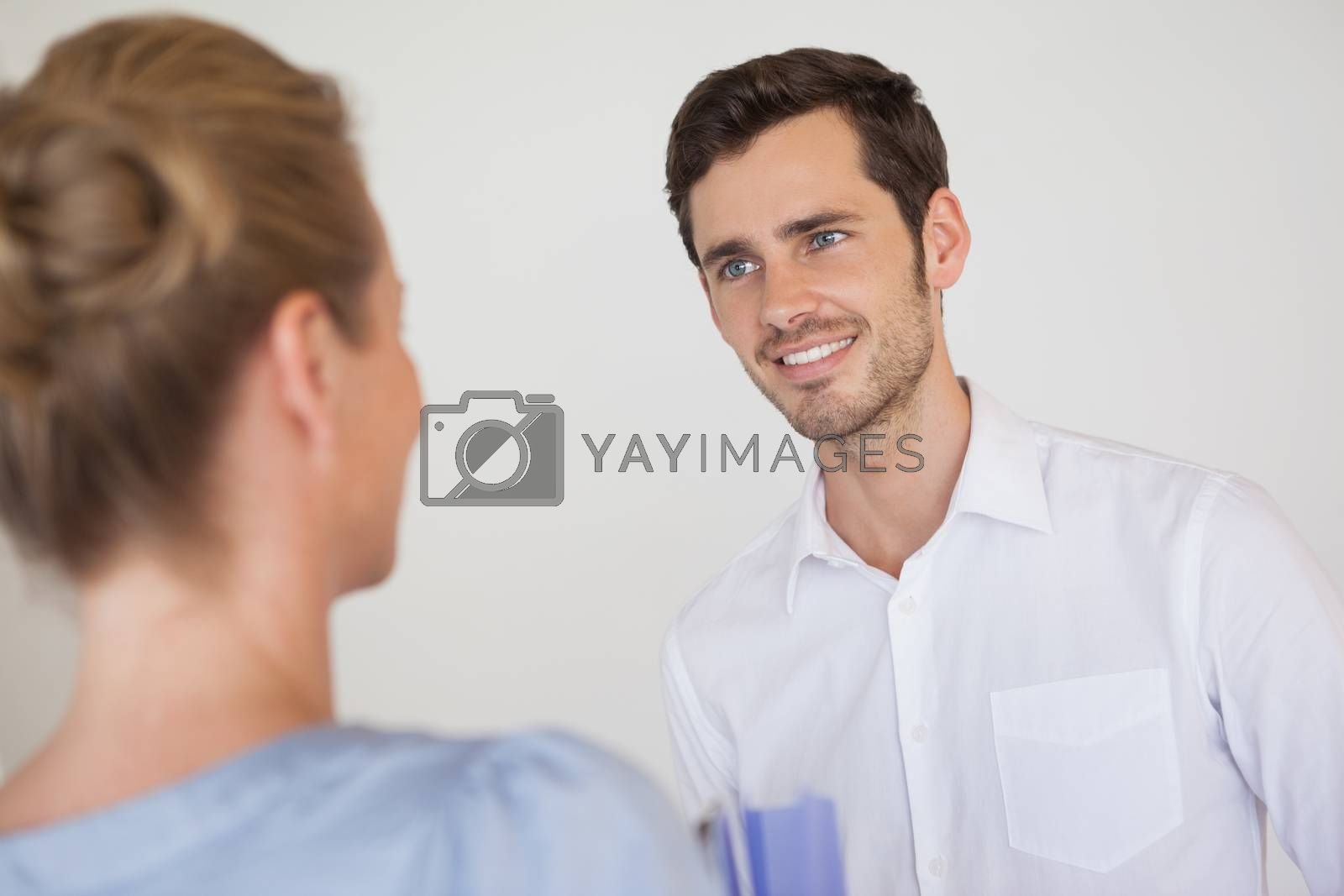 Royalty free image of Casual business people looking at each other by Wavebreakmedia