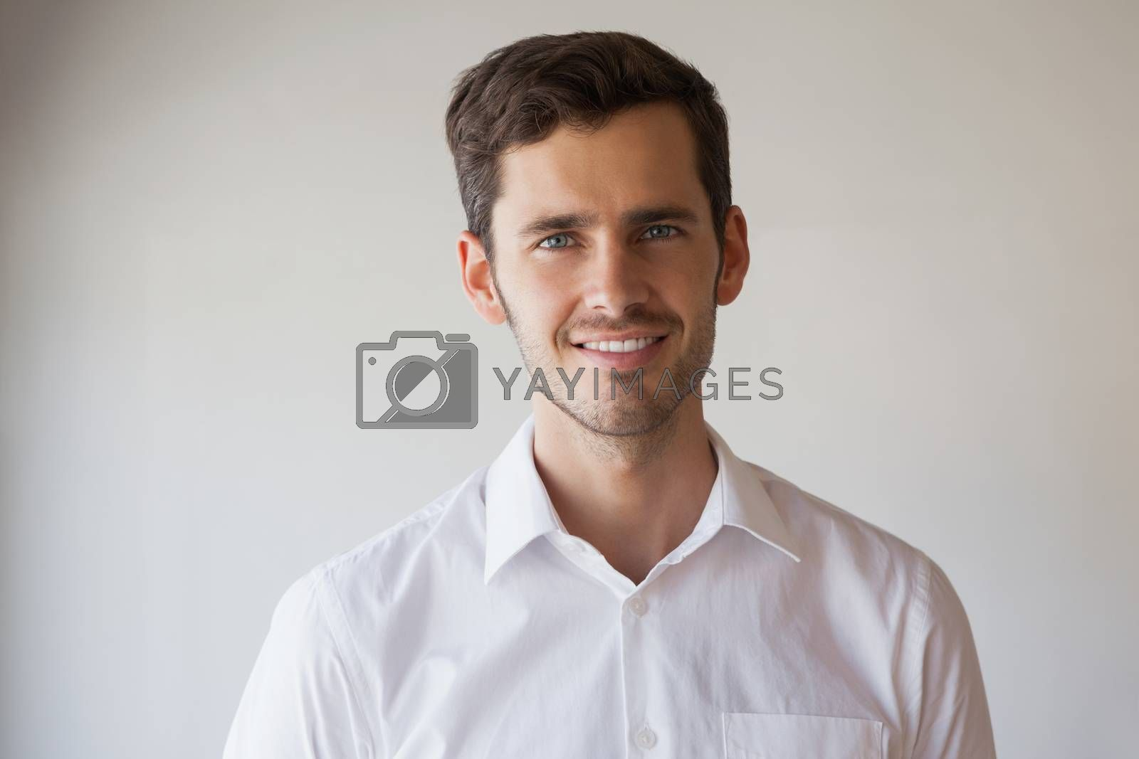 Royalty free image of Casual businessman smiling at camera by Wavebreakmedia