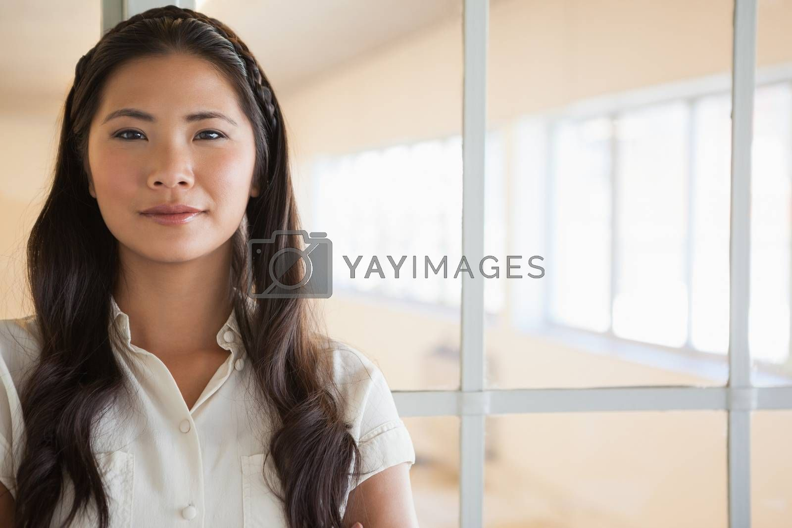 Royalty free image of Casual businesswoman looking at camera by Wavebreakmedia