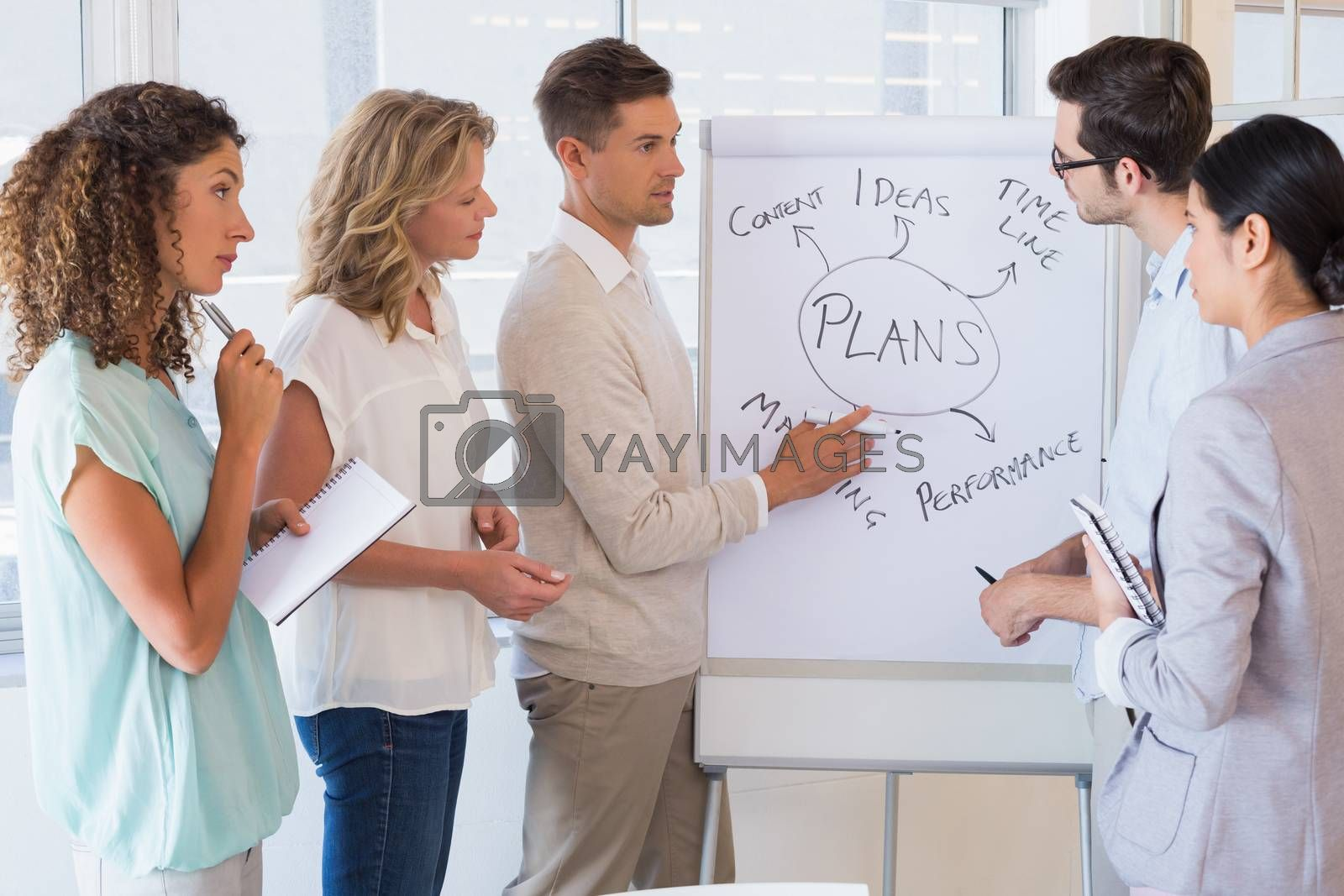 Royalty free image of Casual businesswoman team listening to presentation by Wavebreakmedia