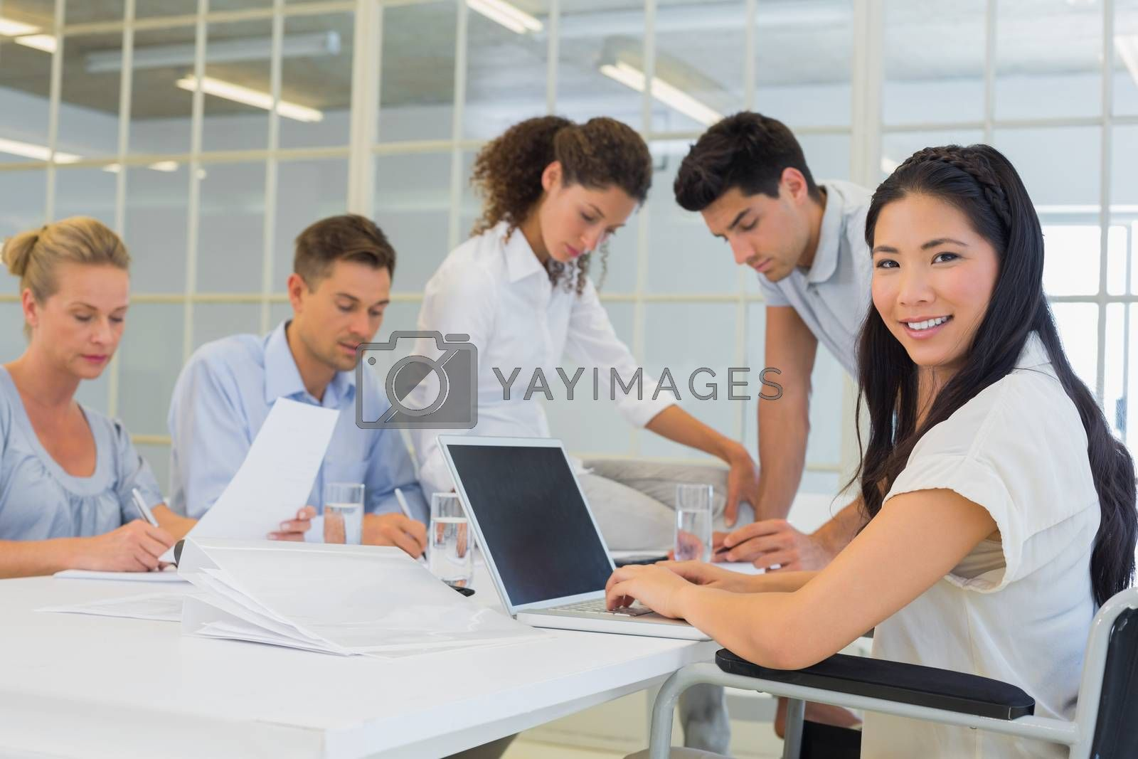 Royalty free image of Casual businesswoman smiling at camera during meeting by Wavebreakmedia