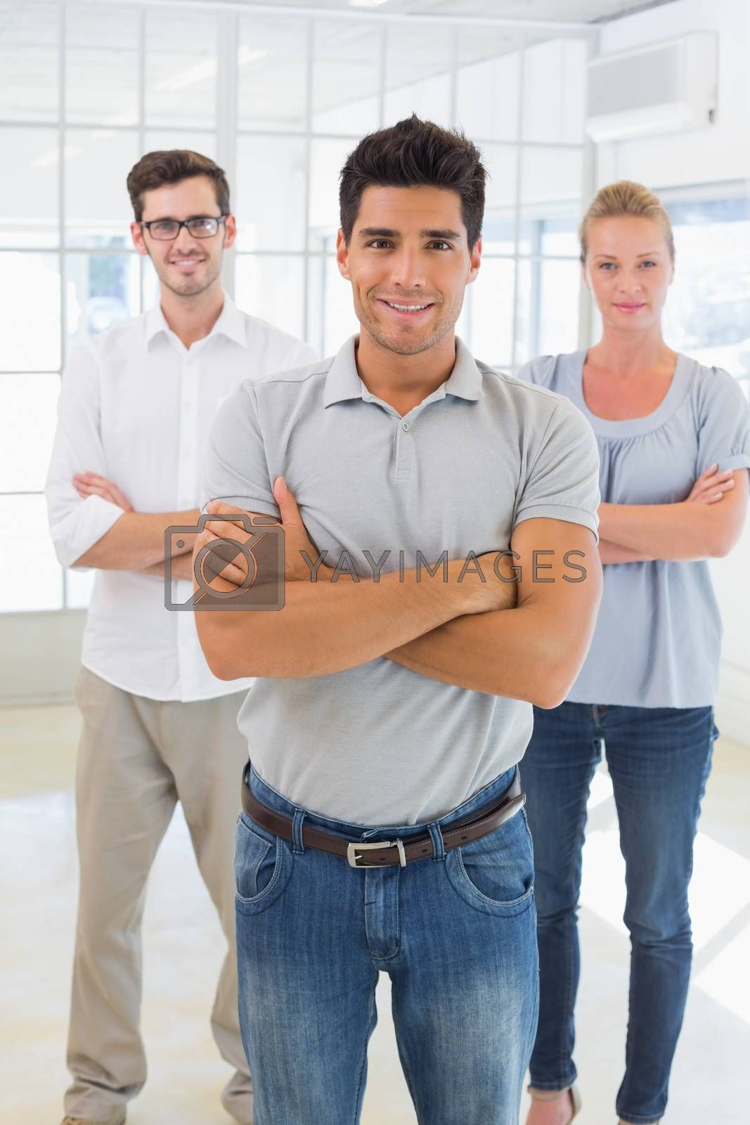 Royalty free image of Casual business team smiling at camera by Wavebreakmedia