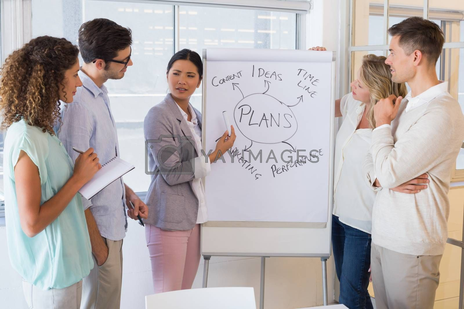 Royalty free image of Casual businesswoman giving a presentation by Wavebreakmedia