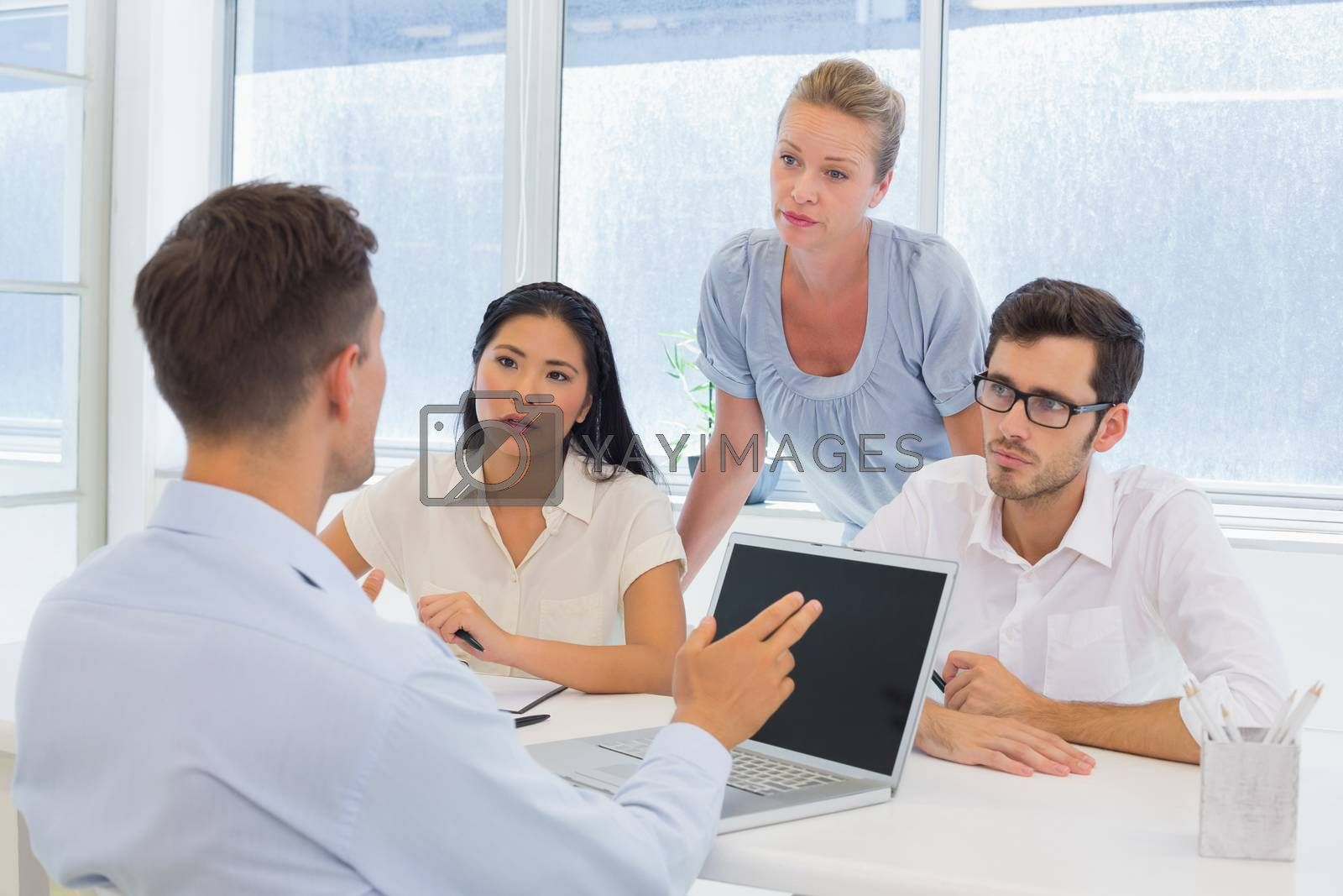 Royalty free image of Casual businessman using his laptop during a meeting by Wavebreakmedia