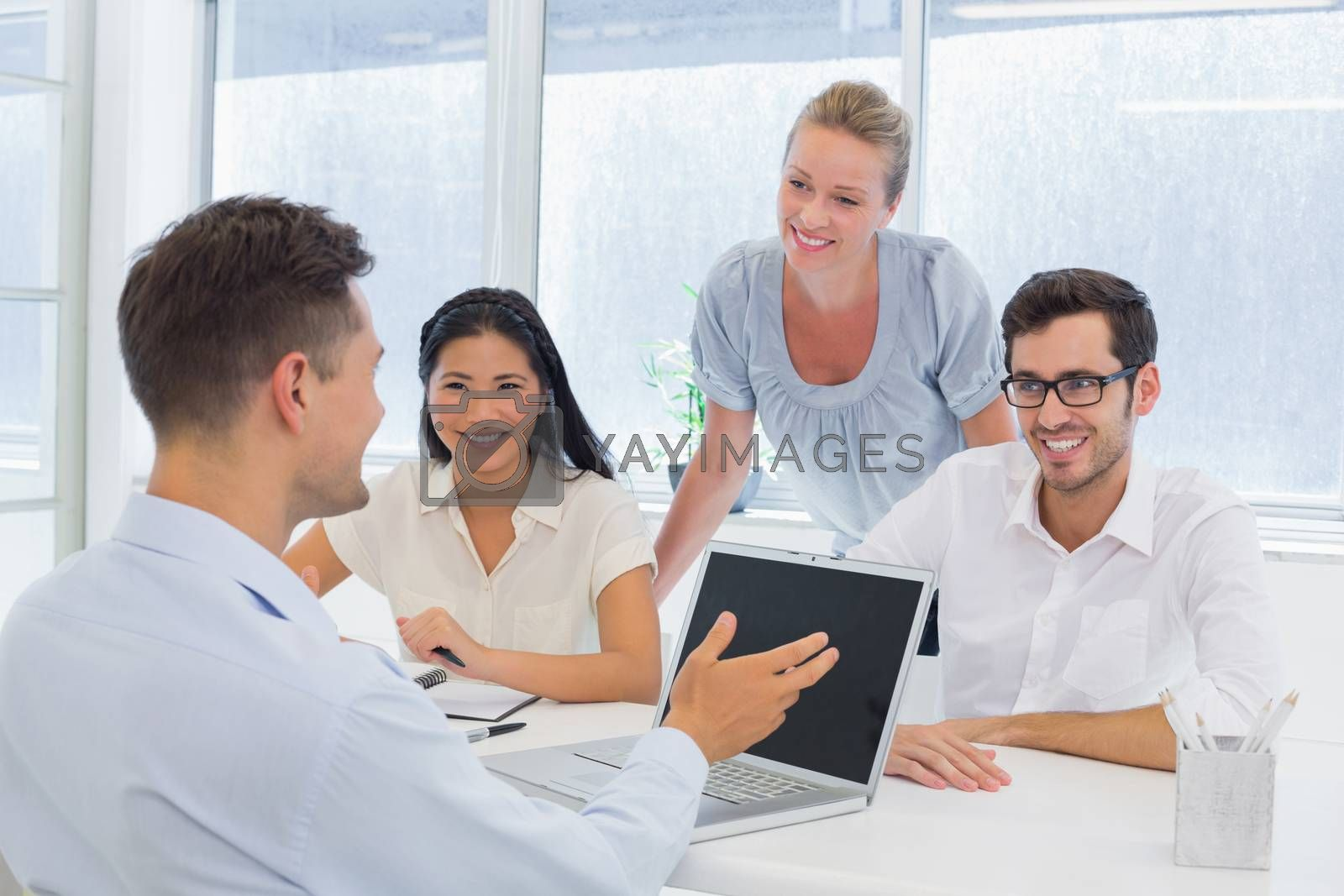 Royalty free image of Casual businessman using laptop during meeting by Wavebreakmedia
