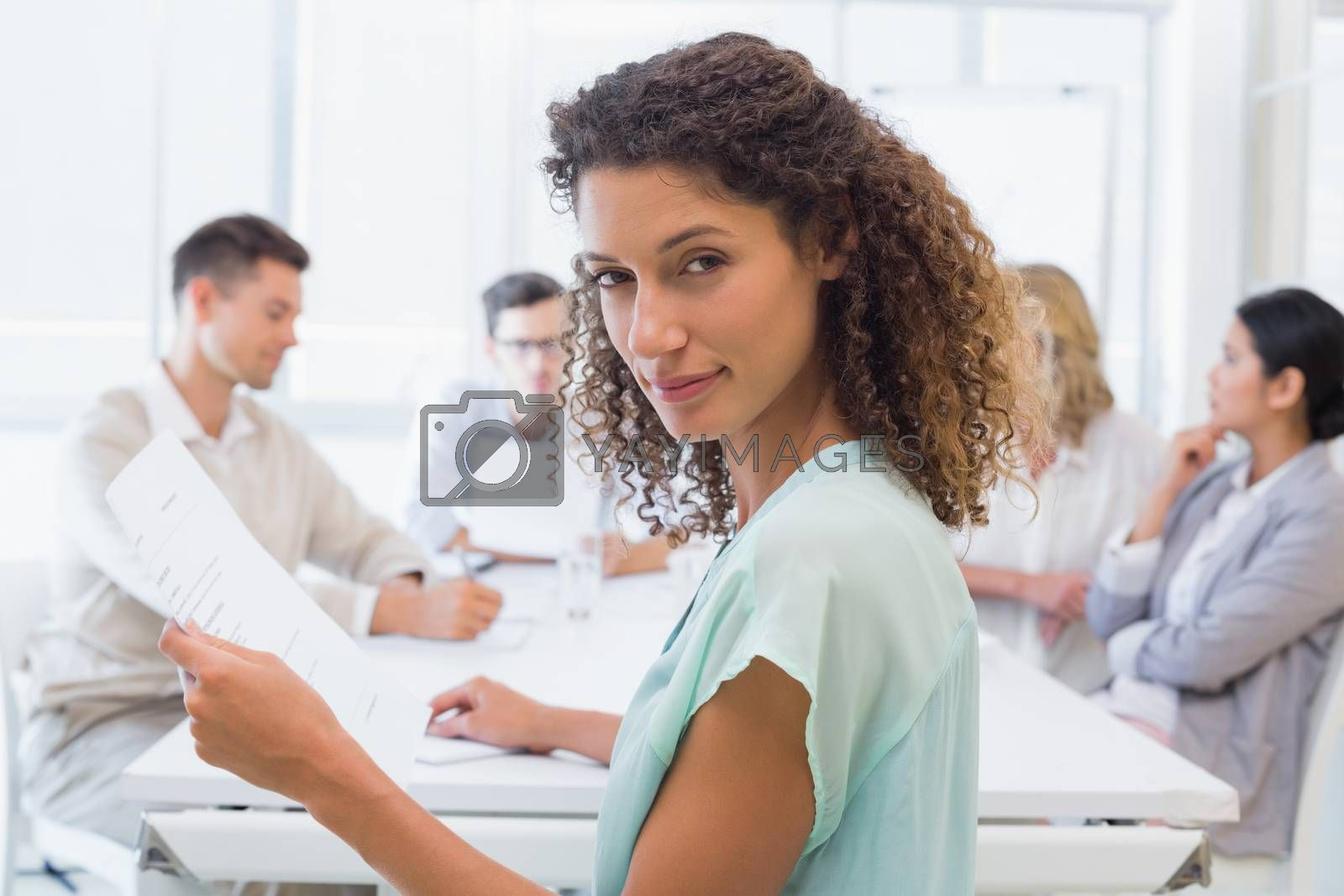 Royalty free image of Casual businesswoman looking at camera during meeting by Wavebreakmedia