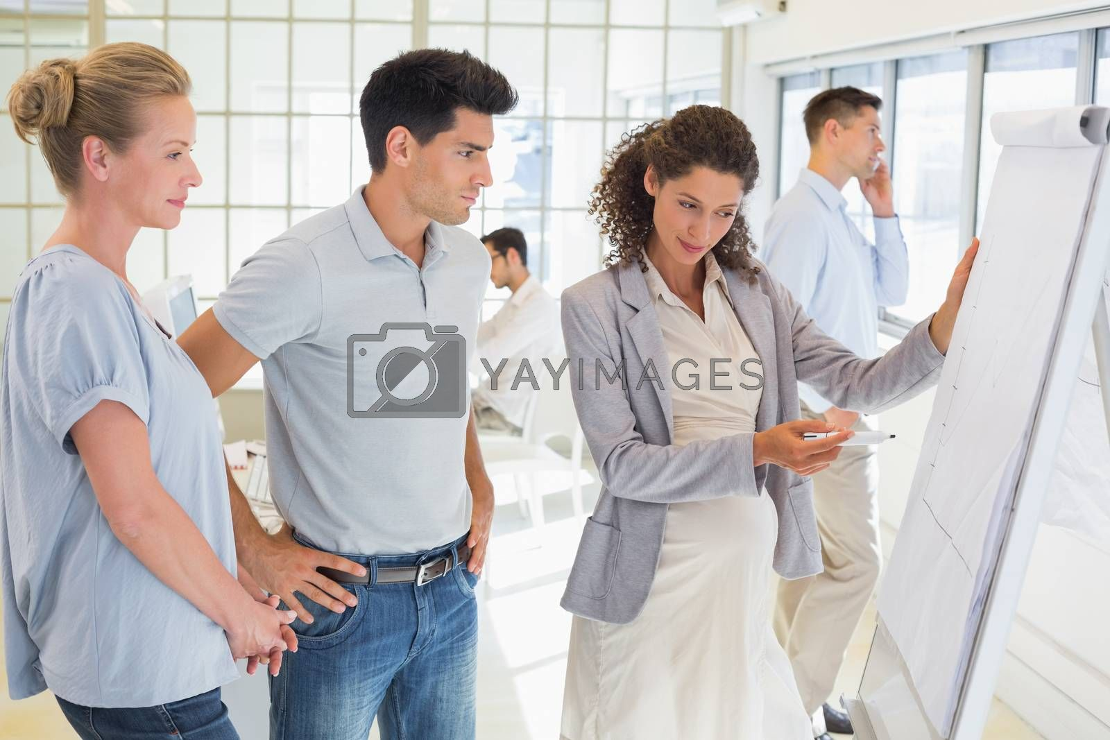 Royalty free image of Pregnant businesswoman presenting her ideas by Wavebreakmedia