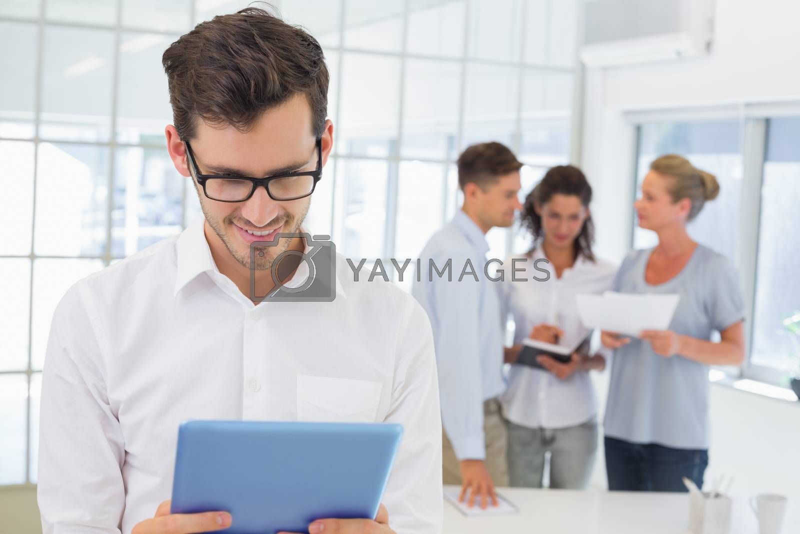 Royalty free image of Casual businessman using his tablet by Wavebreakmedia