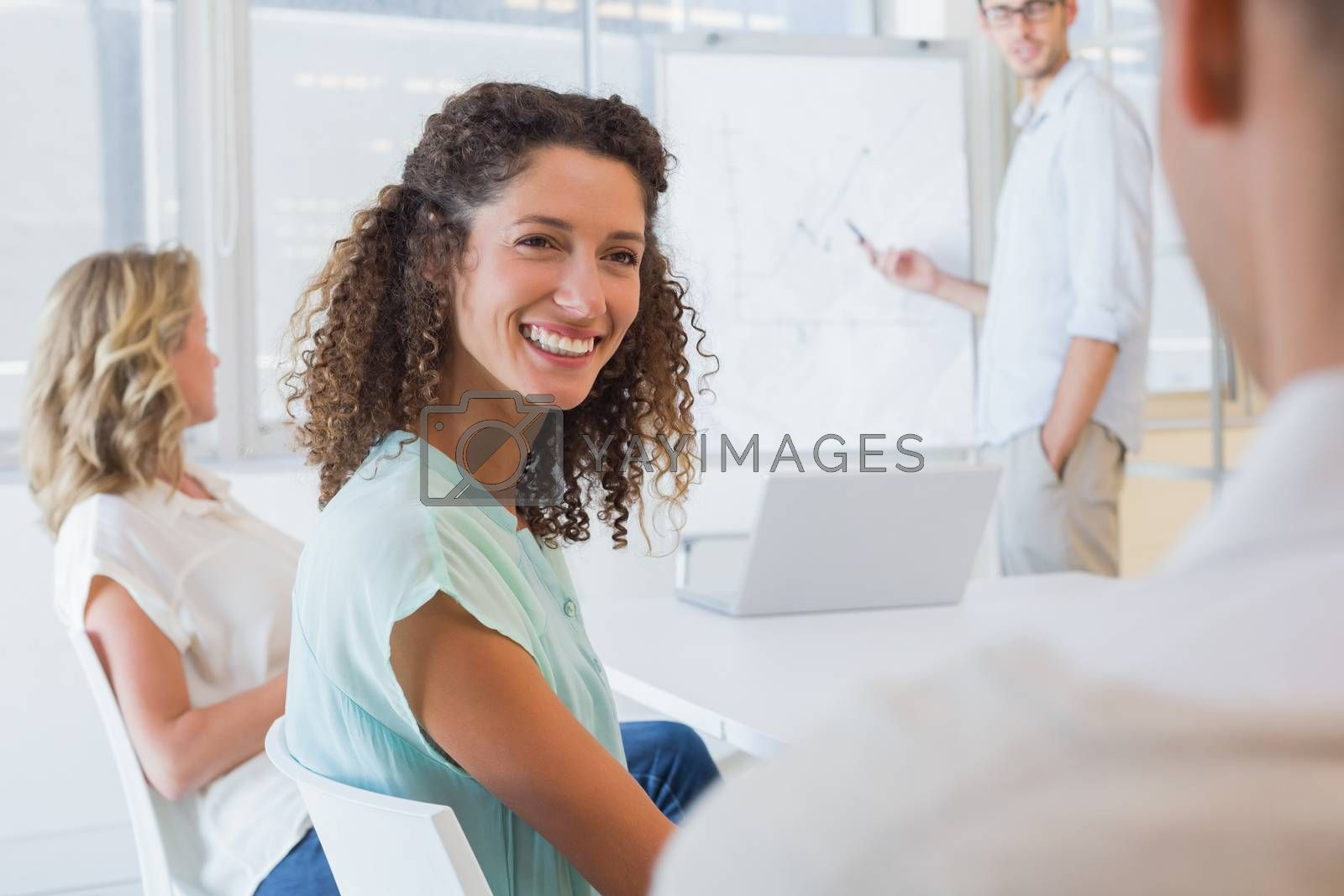Royalty free image of Casual businesswoman smiling at colleague during meeting by Wavebreakmedia