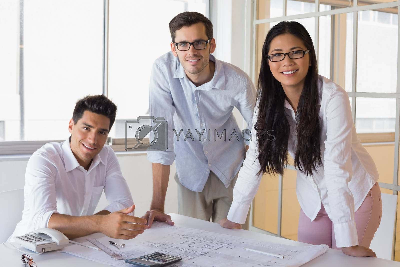 Royalty free image of Casual architecture team working together smiling at camera by Wavebreakmedia