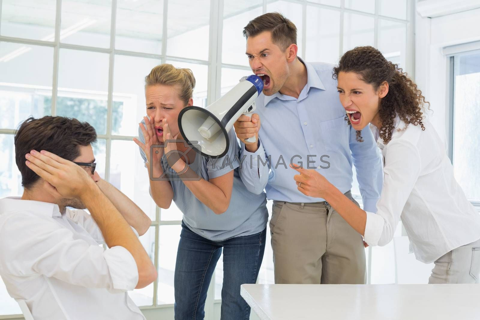 Royalty free image of Casual business team shouting at a colleague by Wavebreakmedia