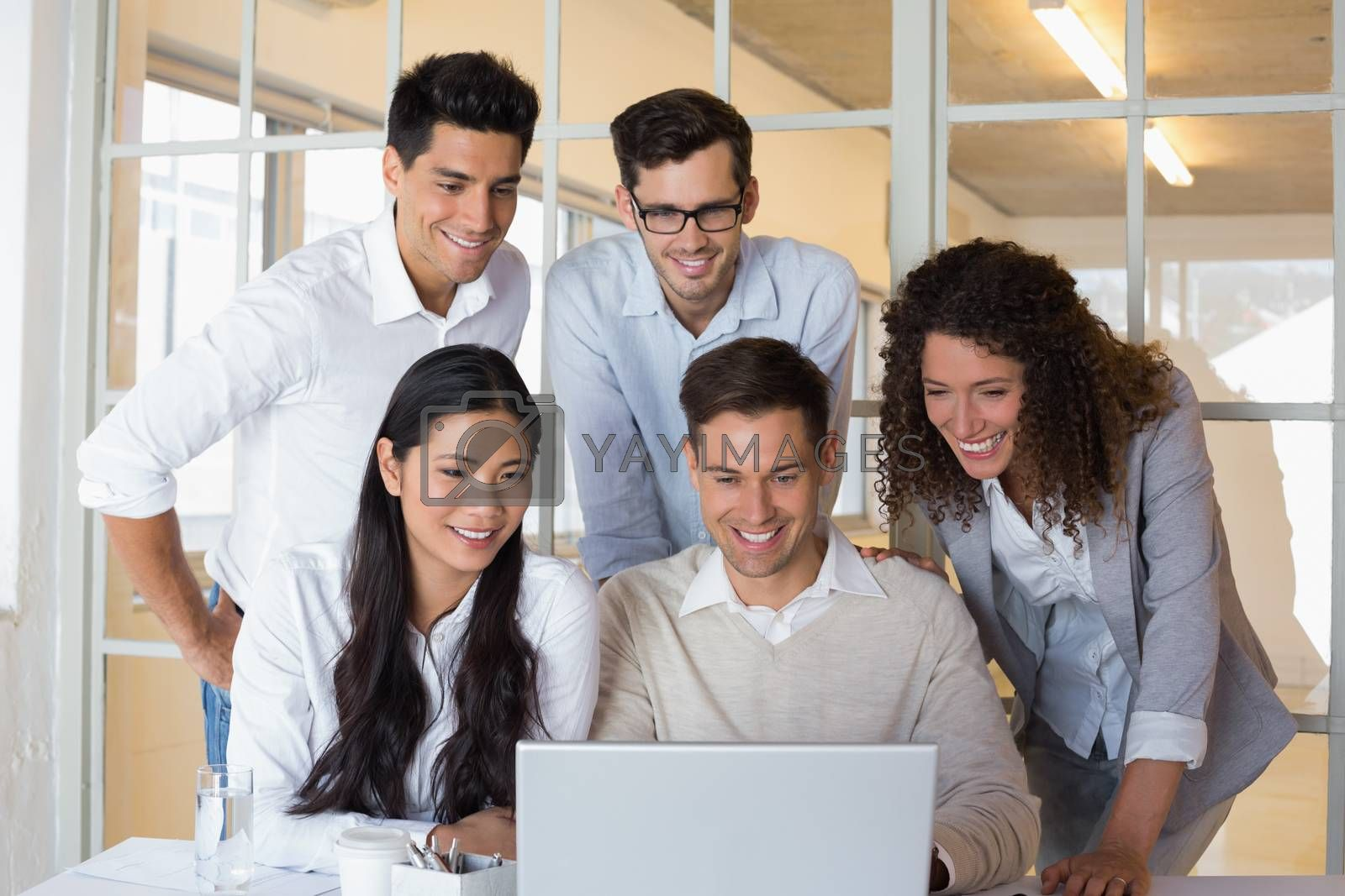 Royalty free image of Casual business team having a meeting using laptop by Wavebreakmedia