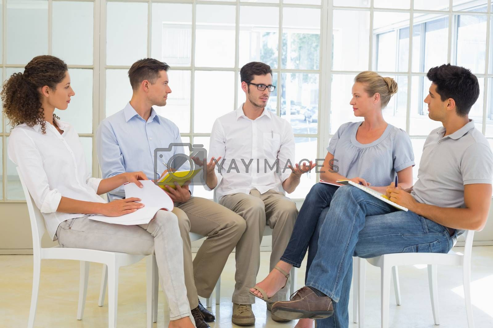 Royalty free image of Casual business team sitting in a circle having a meeting by Wavebreakmedia