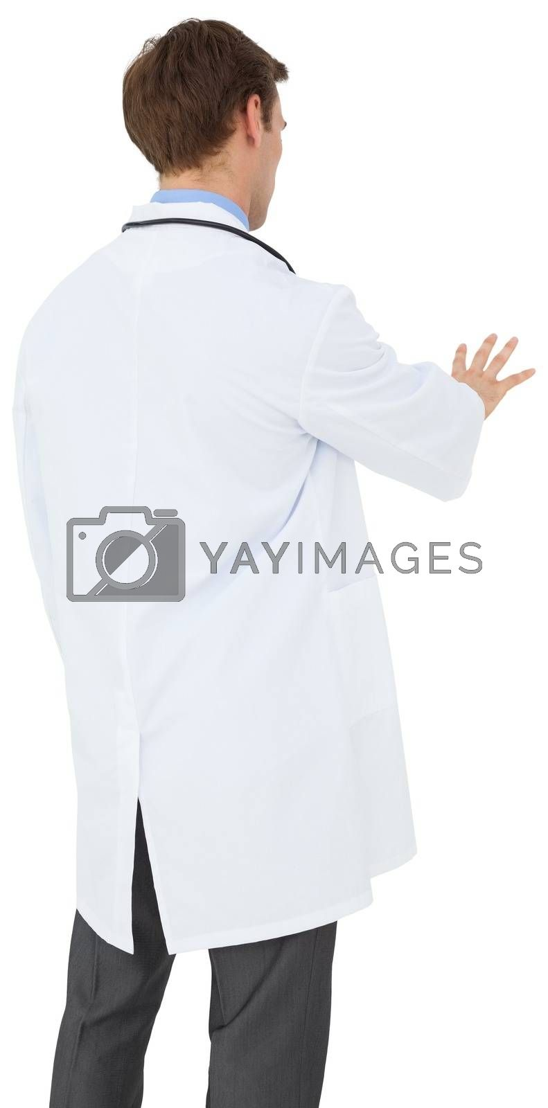 Royalty free image of Young doctor in lab coat gesturing by Wavebreakmedia