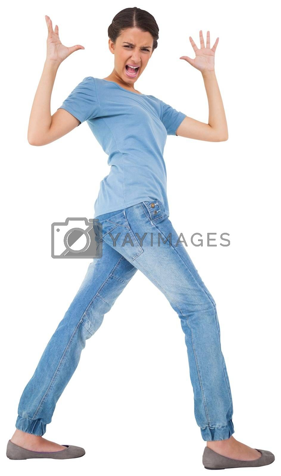 Royalty free image of Annoyed pretty young brunette gesturing by Wavebreakmedia
