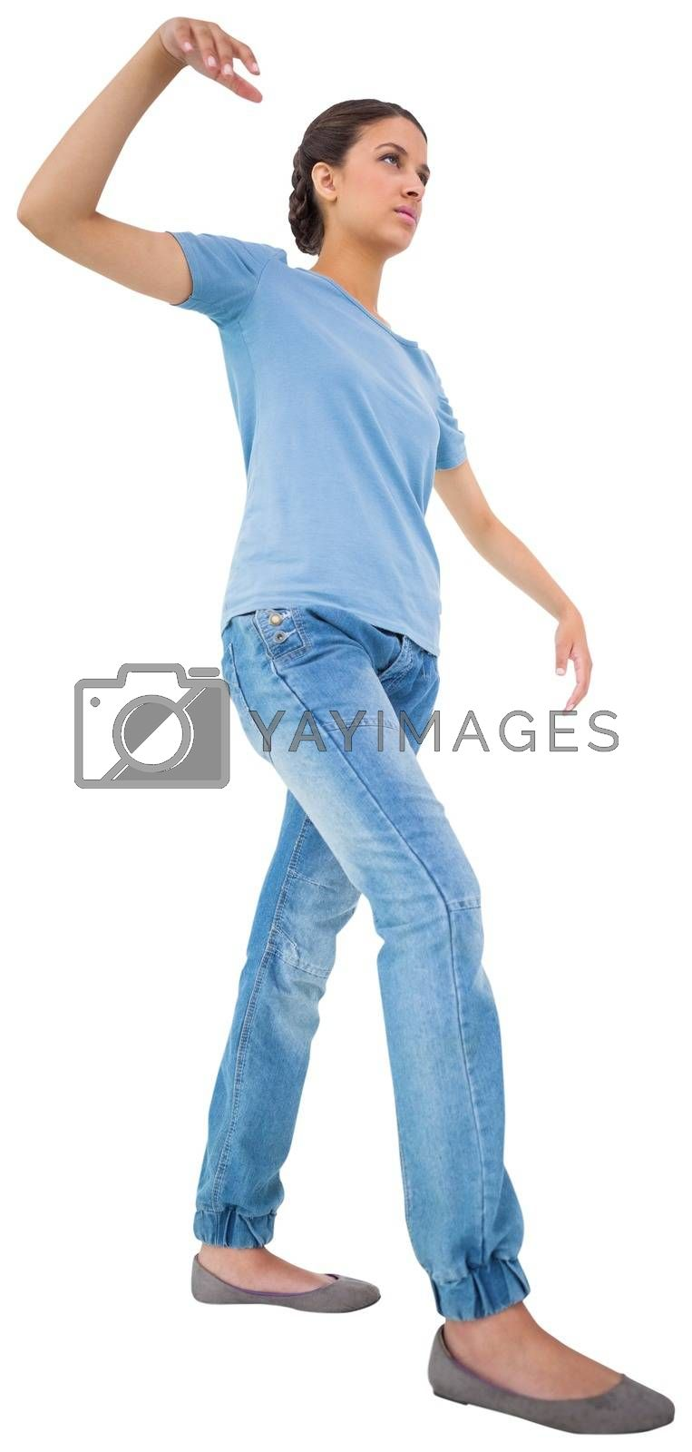 Royalty free image of Powerless brunette in jeans and tshirt by Wavebreakmedia