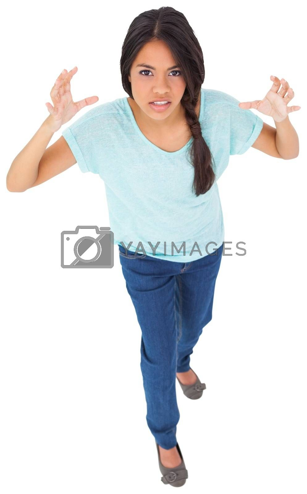 Royalty free image of Angry young casual brunette gesturing by Wavebreakmedia