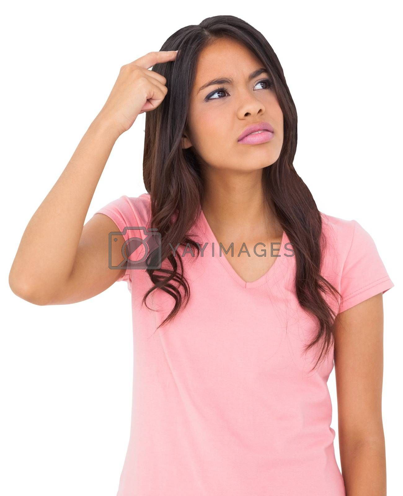 Royalty free image of Pretty young casual brunette thinking by Wavebreakmedia