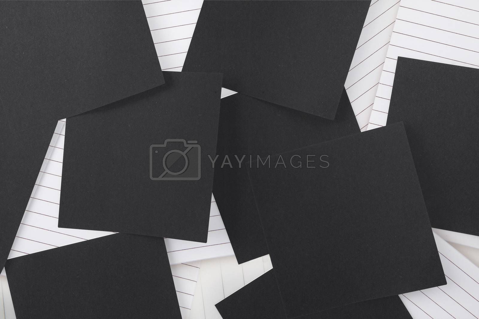 Royalty free image of Black paper strewn over notepad by Wavebreakmedia
