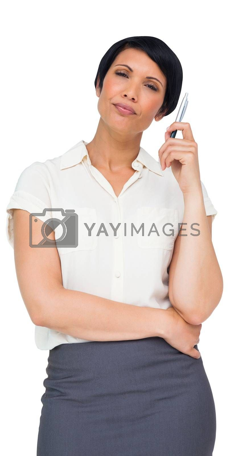 Royalty free image of Thoughtful brown haired businesswoman in skirt by Wavebreakmedia