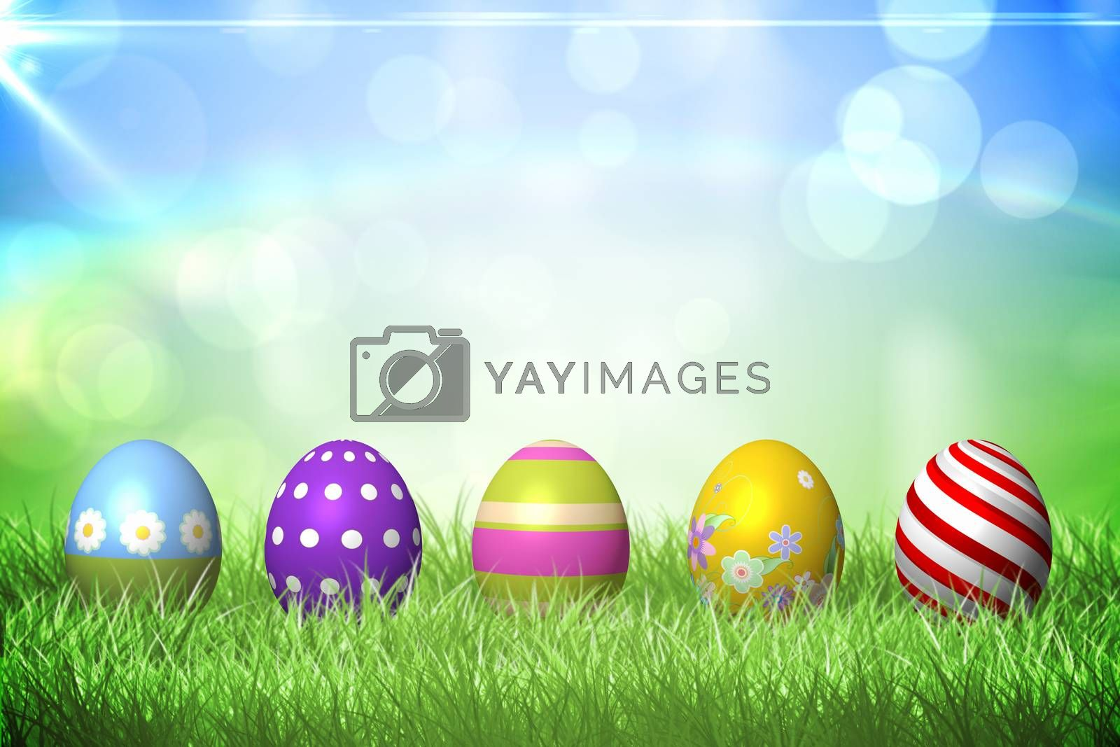 Royalty free image of Colourful easter eggs on the grass by Wavebreakmedia