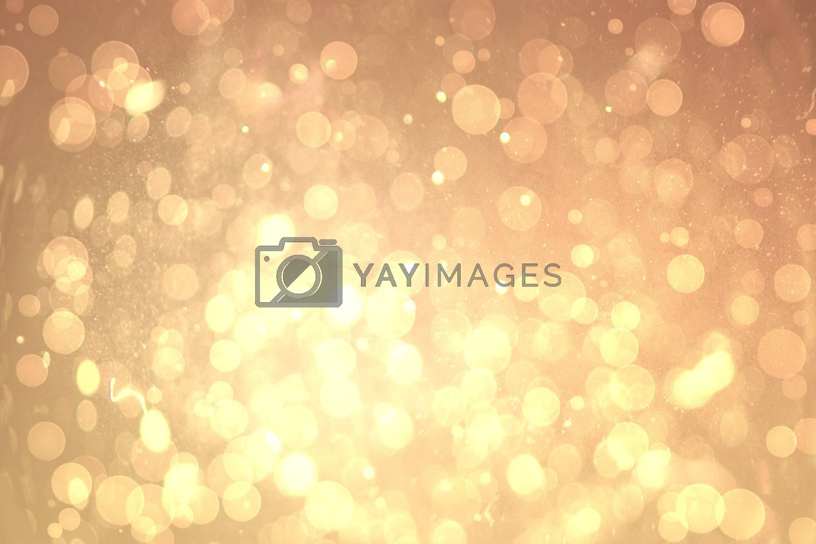 Royalty free image of Yellow abstract light spot design by Wavebreakmedia