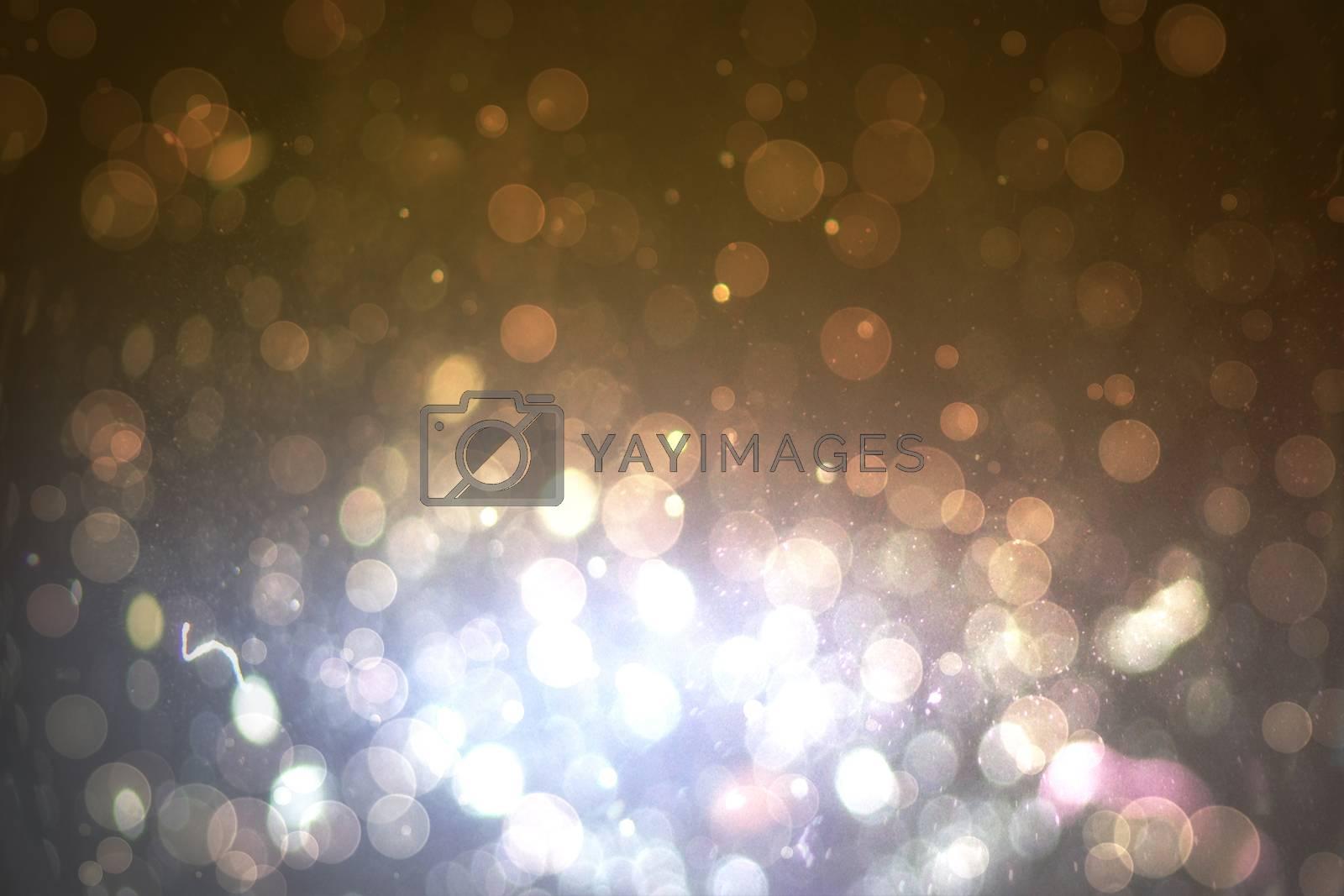 Royalty free image of Dark abstract light spot design by Wavebreakmedia