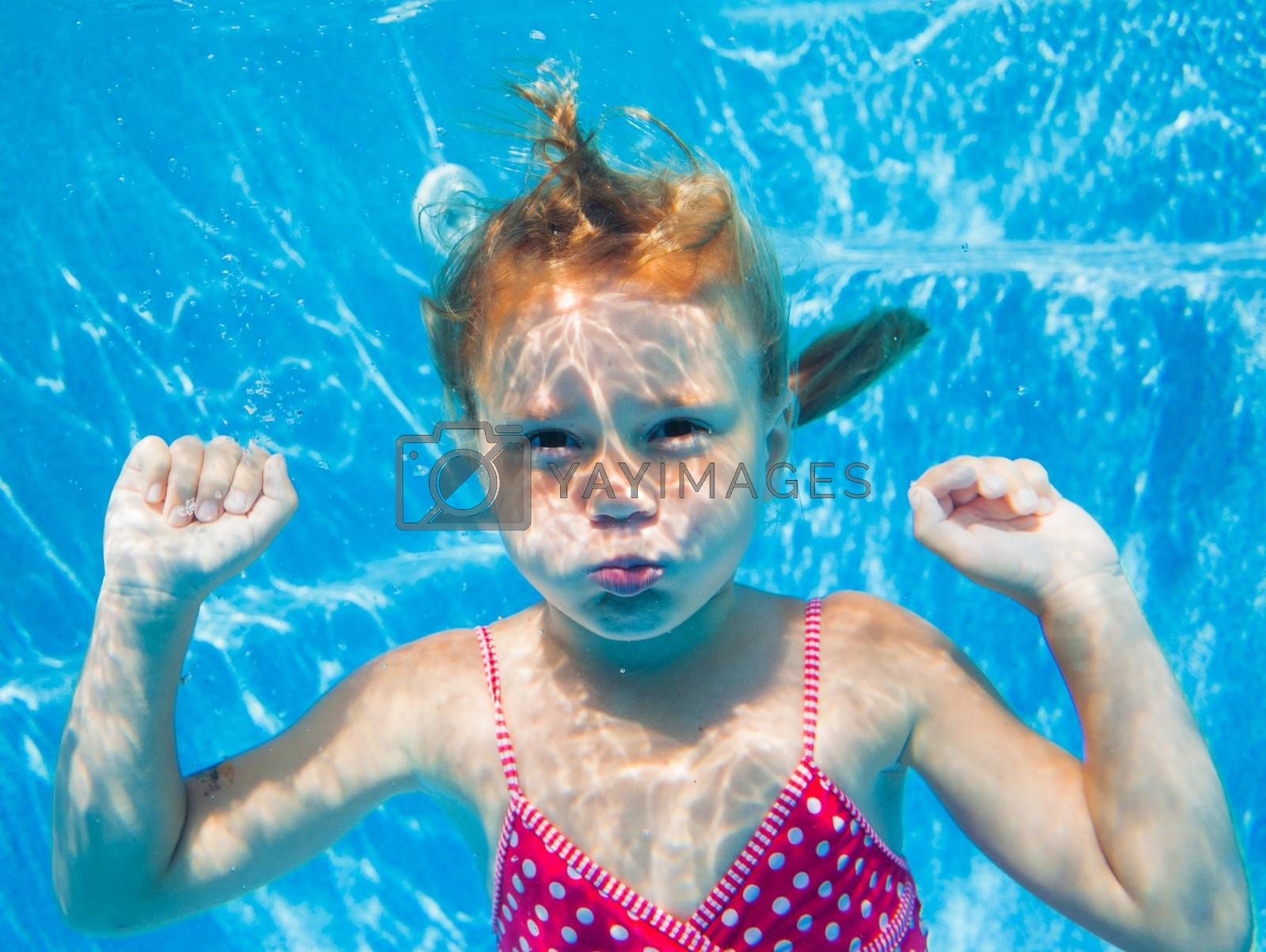 Royalty free image of Underwater girl by maxoliki
