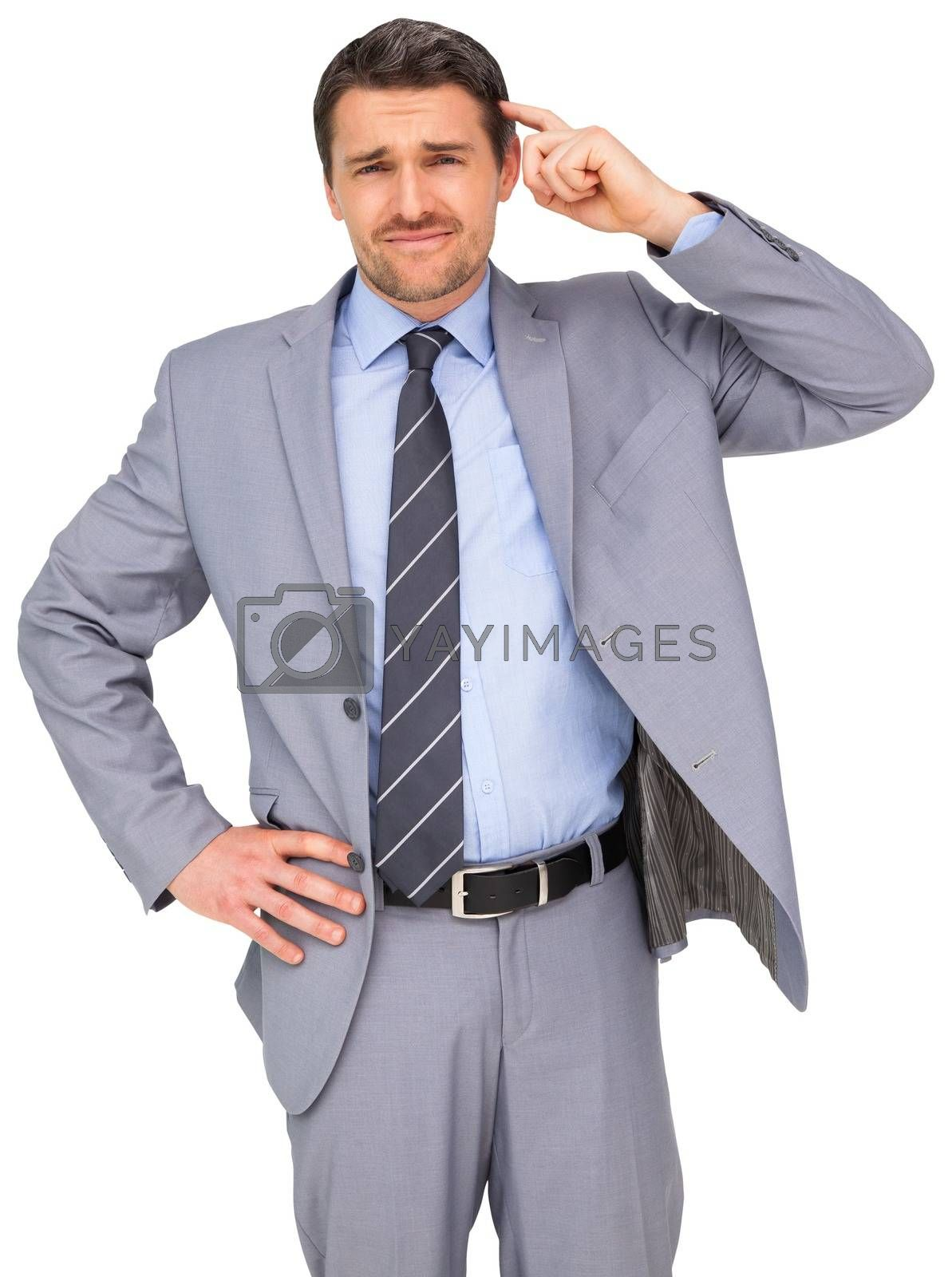 Royalty free image of Thinking businessman in grey suit by Wavebreakmedia