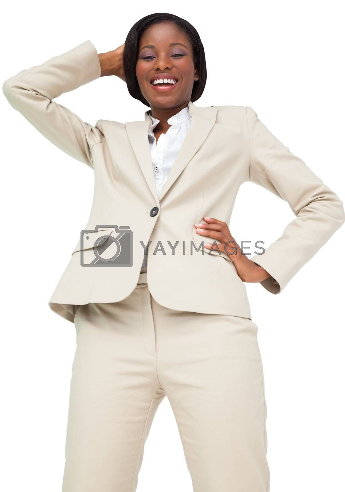 Royalty free image of Thinking businesswoman in cream suit by Wavebreakmedia