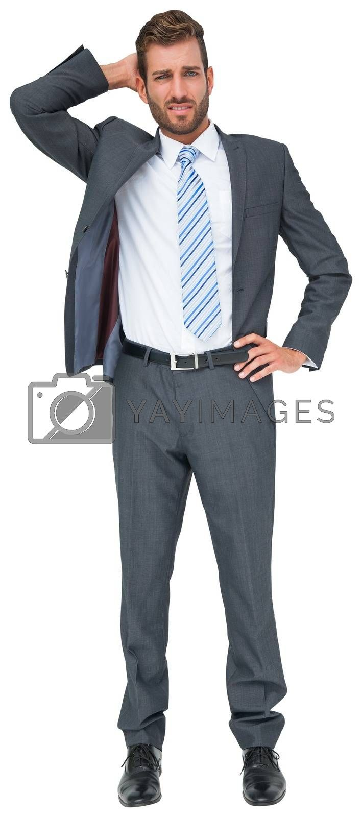 Royalty free image of Thinking businessman with hand on head by Wavebreakmedia