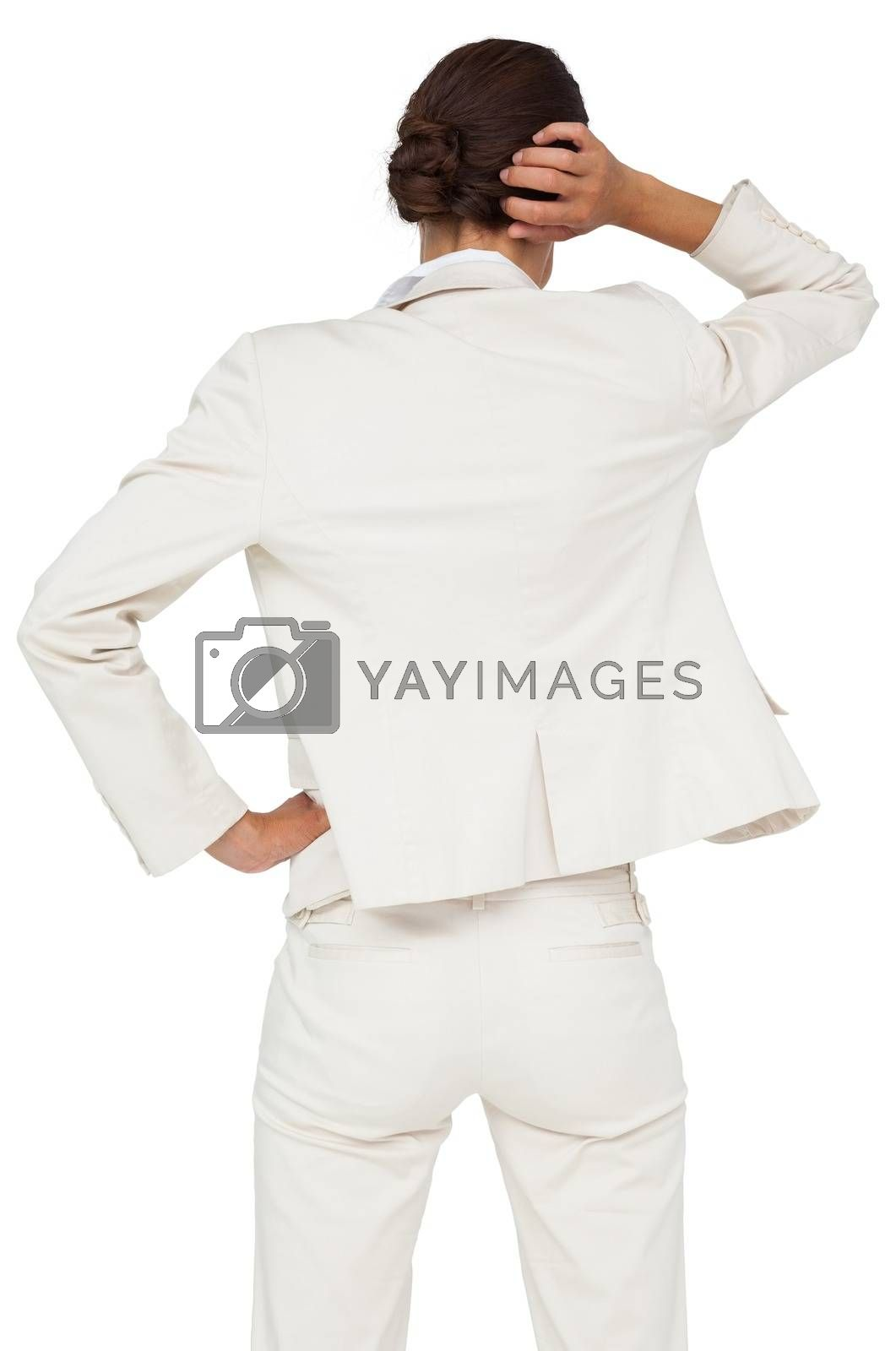Royalty free image of Thinking businesswoman with hand on head by Wavebreakmedia