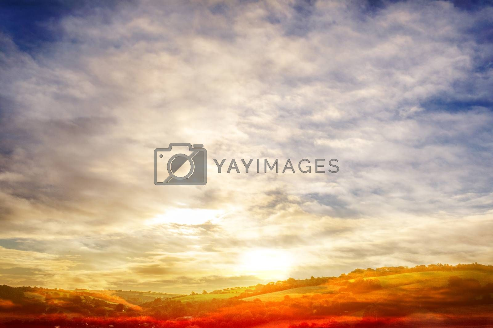 Digitally generated scenic landscape with blue cloudy sky