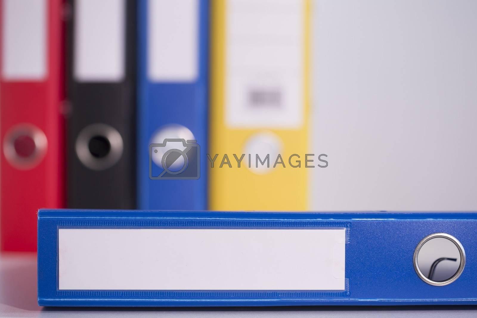Royalty free image of Blue business binder by Wavebreakmedia