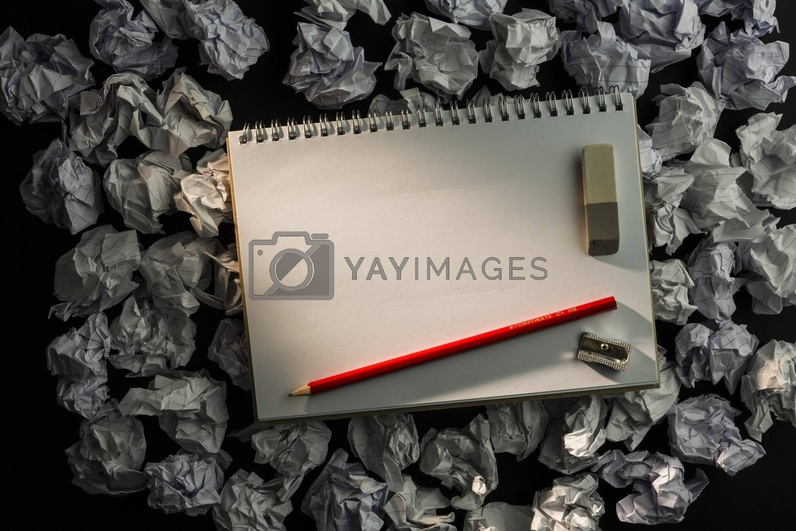 Royalty free image of Paper notebook with pencil eraser and parer by Wavebreakmedia