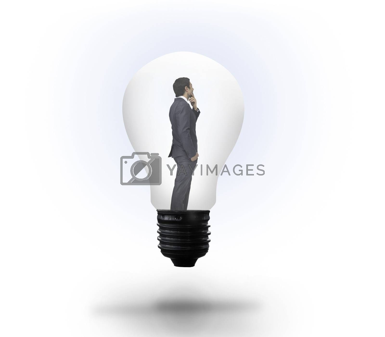 Royalty free image of Thinking businessman in light bulb by Wavebreakmedia
