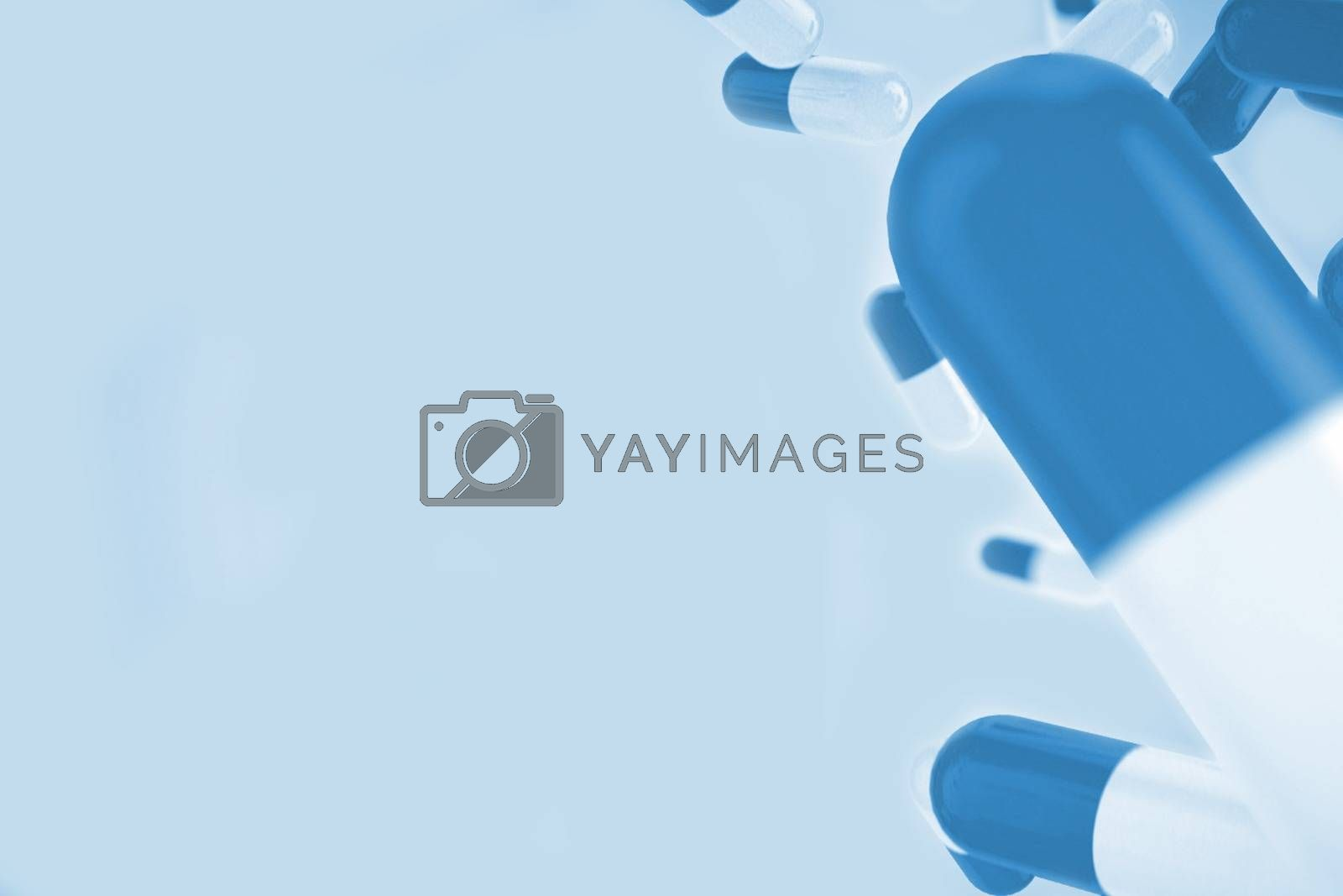 Royalty free image of Blue medical background with pills by Wavebreakmedia