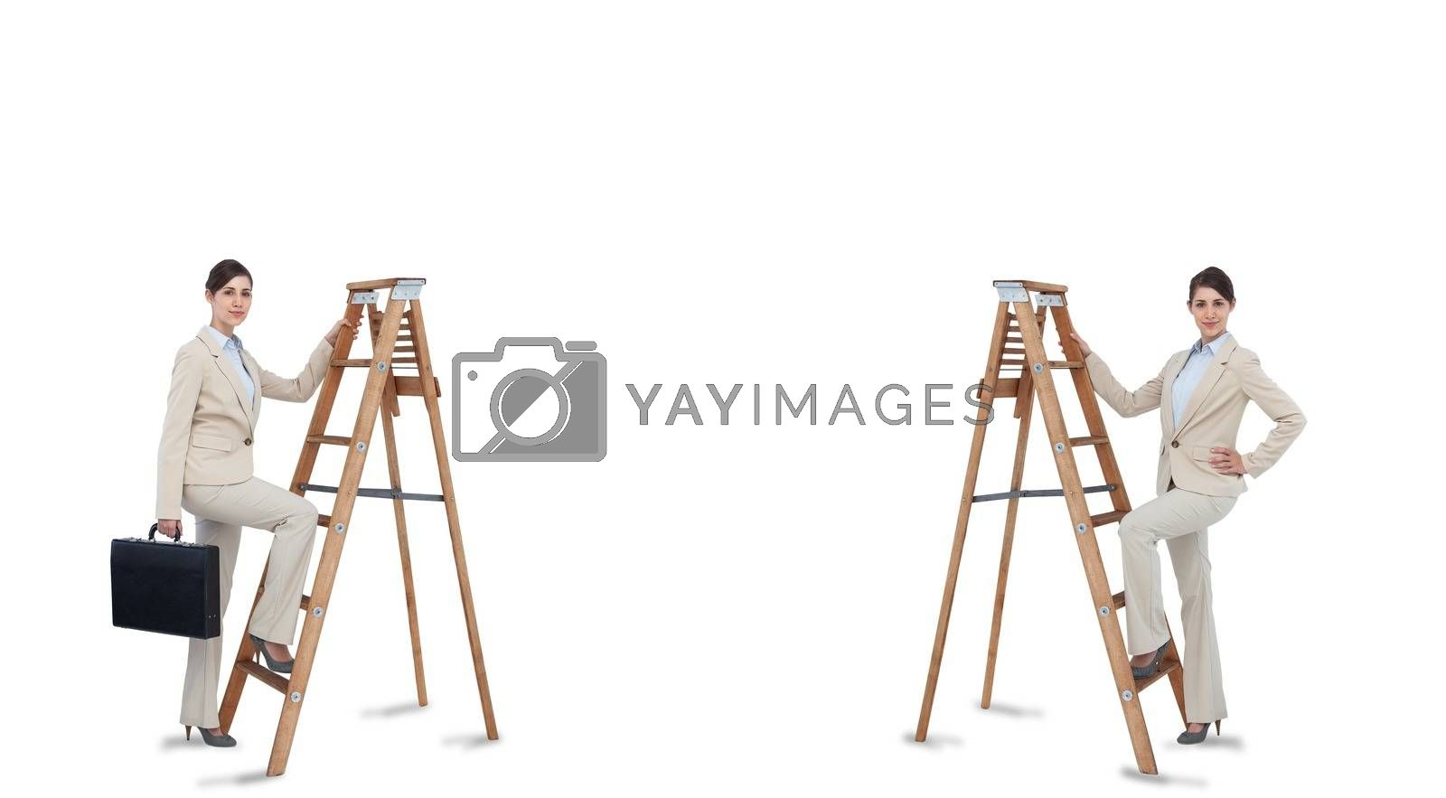 Royalty free image of Multiple image of businesswoman climbing ladder by Wavebreakmedia