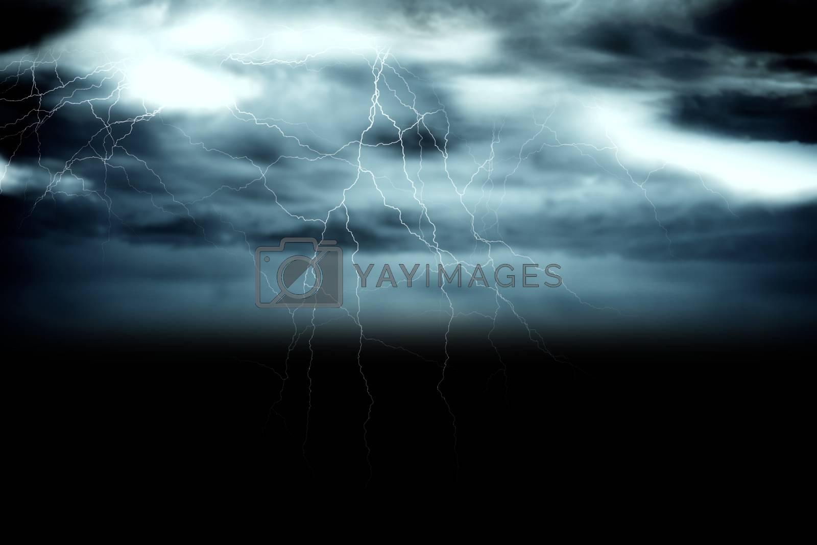 Royalty free image of Stormy dark sky with lightning bolts by Wavebreakmedia