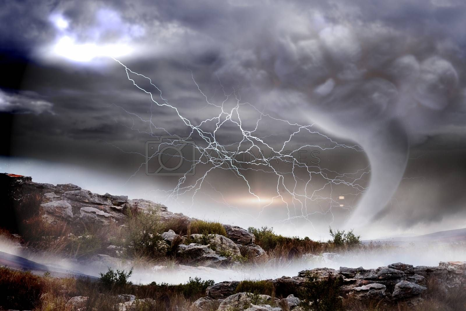 Royalty free image of Stormy sky with tornado over landscape by Wavebreakmedia