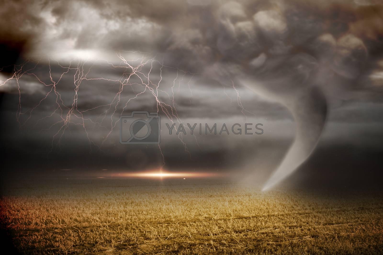 Royalty free image of Stormy sky with tornado over field by Wavebreakmedia