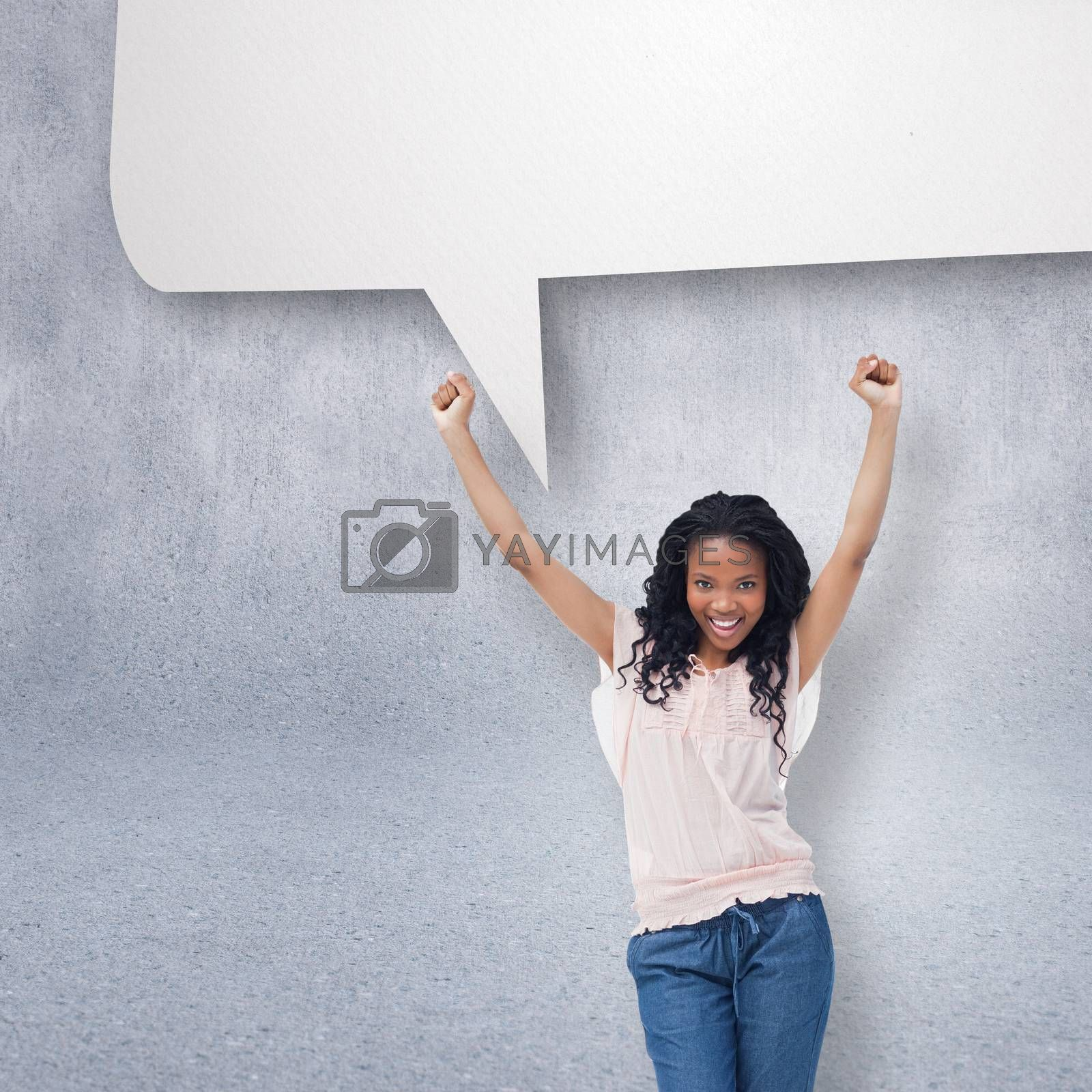 A young happy woman with speech bubble against grey wall
