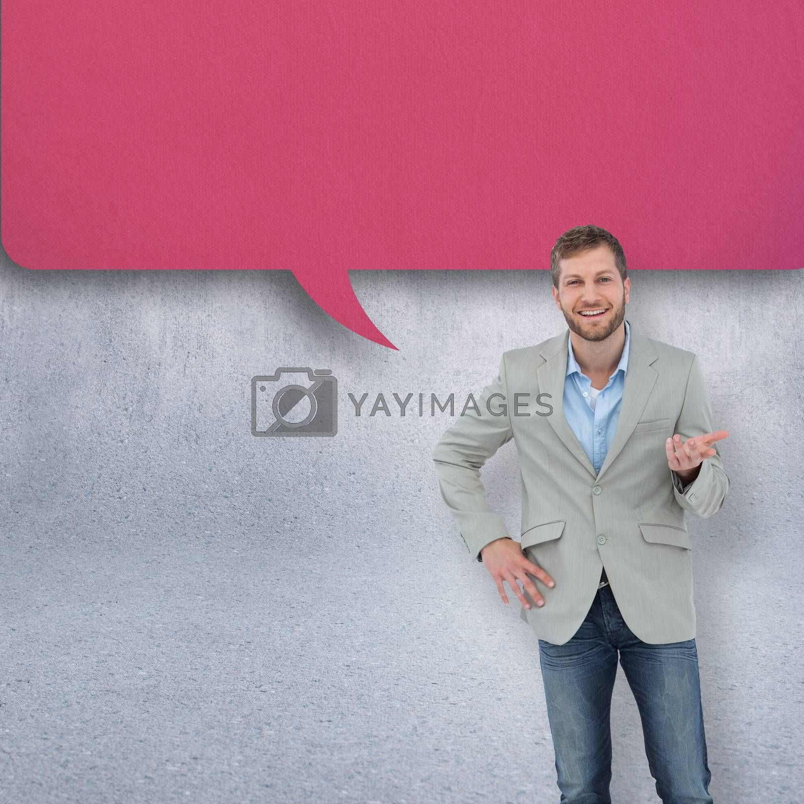 Stylish man smiling and gesturing against grey wall with speech bubble