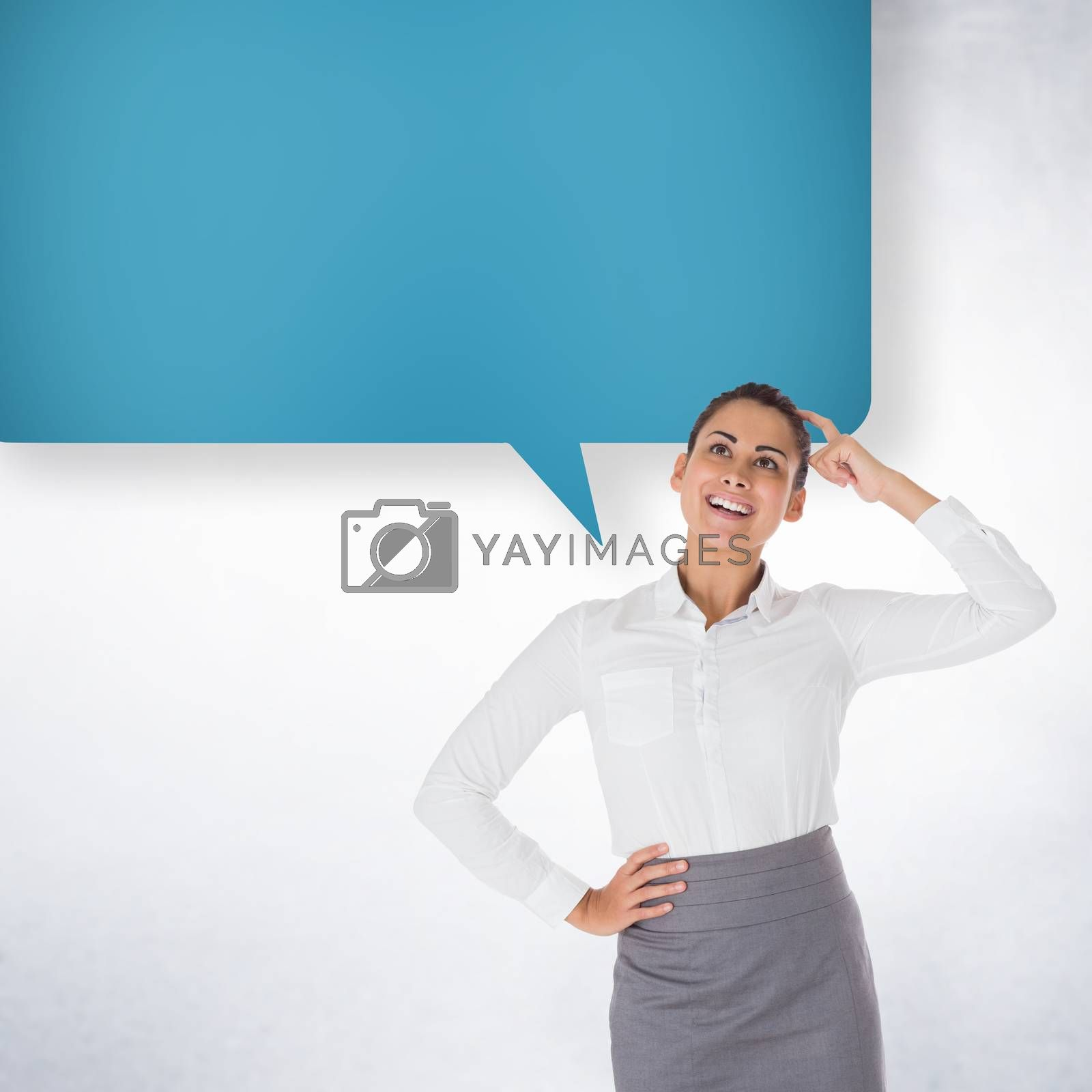 Smiling thoughtful businesswoman with speech bubble against white wall