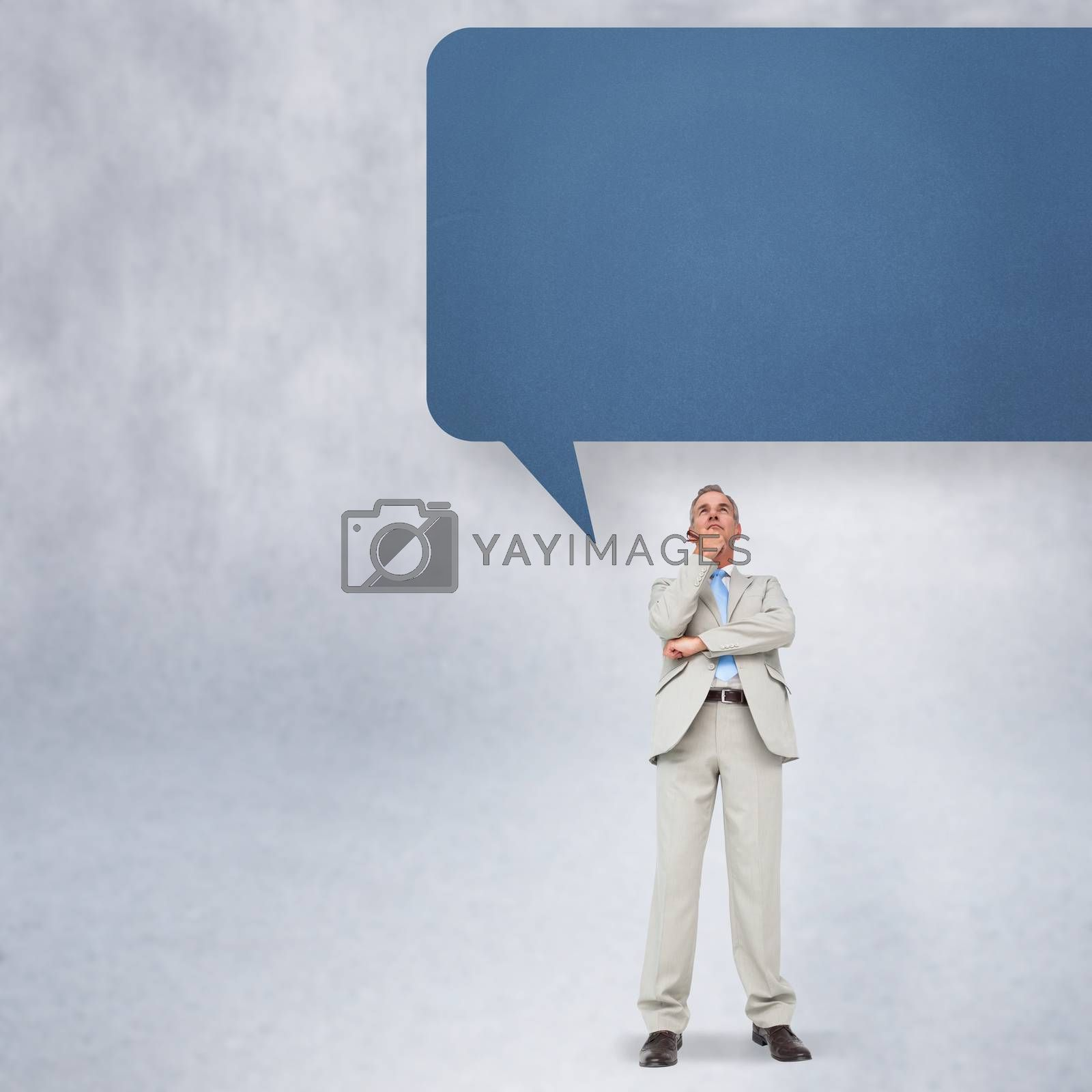 Thinking businessman with speech bubble by Wavebreakmedia